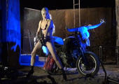Mosh model in blue flam, with bike and gun.