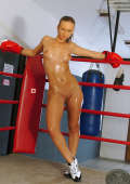 Sporty boxer girl naked with oiled body