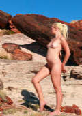 Tatyana pose nude among rare 20 million year old petrified wood in the Painted Desert of Arizona simply breathtaking