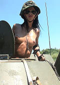 Susanna riding topless on military tank