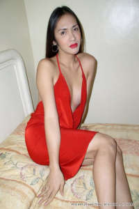 Shemale Uschi in red dress on bed