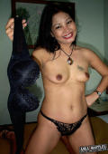Nadia shows off her black bra and panties.