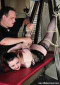 Goth girl in extreme bondage