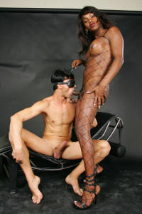 Black Tranny in fishnet gets oraly pleasured