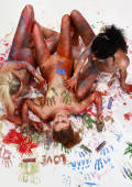 three bodypainted girls messing around