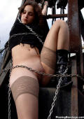 chained up girl is pissing outdoors