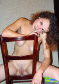 Girl with nice big natural tits spreading on a chair showing het cunt