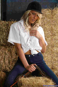 blond girl Diana posing in the stable 11