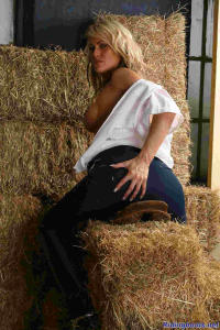 blond girl Diana posing in the stable 10