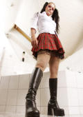 Schoolgirl fetish model in high boots.