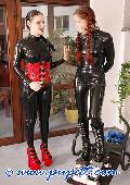 ponygirl and mistress dressed in red and black latex 11