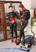 ponygirl and mistress dressed in red and black latex 12