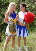 Two young erotic cheerleaders licking their pussies outdoors.