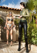 Slavegirl in chains and chustitybelt outdoor.