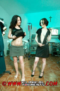 Two kinky girls geting ready for clinical fetish action