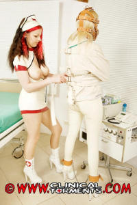 Latex nurse and restrained girl in fetish clinic