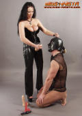 Punishment for slaveboy with strapon dildo