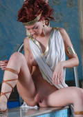 redhead girl in tunika dressed like a roman whore