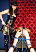 Latex Dominatrix femdom slave training, spanking and punishment