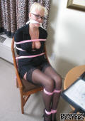 Ponytailed blonde office babe in glasses gets tied up and gagged on the chair.