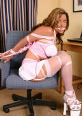 Elegant blonde doll Christina Carter gets tied up and gagged.