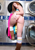 Girl shows her nice butt at the laundry
