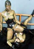 Two Latexgirls play with big black dildo