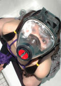 Little asian chick with gas mask is restrained.
