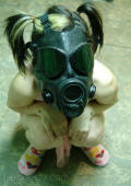 Chick with permanent scars wearing her gas mask in her basement.