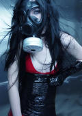 Raven teen gaged and bound with a gas mask placed over her head.