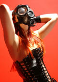 Mistress V in lace latex garb and her ww II gas mask.