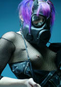 Gothic femme in a gas mask and a fishnet body suit.