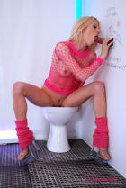Blond Gloria in pink fishnets and socks blowing my horn.