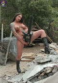 Erotic dangerous busty tattoo beauty with chainsaw.