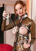 Lesbian Domina prepares the handcuffs for her slavegirls.