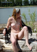 Hairy dreadlocked, unshaved, hippie girl at the beach