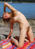 Blond, very hairy hippie girl with glasses and hairy pits stretches at the beach