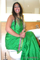 Indian Suckdoll Anjali green dress smiling.