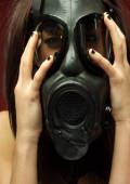 Gas mask slut shows her erect nipples.