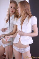 Cute teen Angie posing with white lingery in front of mirror.