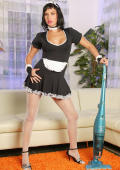 Chick in maid uniform showing her tits and stocking legs