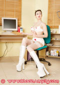 Nurse in white highheeled  boots.