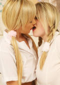 two lesbian pigtailed girls kissing