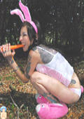 Tattooed amateur teen Easter Bunny cutie with carrot.