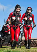 Ponygirls in red latex trained outdoor.