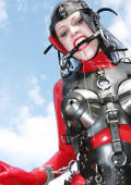 Pony girl in red latex and heavy harness outdoor.