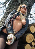 Fetish girl in outdoor bondage game