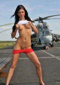 Raventeen posing on airport with helicopter