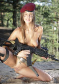 Military girl outdoor pleasure with gun in action