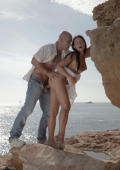 Gorgeous Gianna and Pablo make passionate love with the wind in their hair and sea at their feet. Hot!